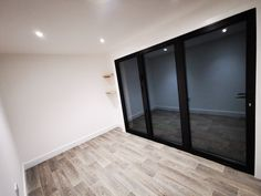Black aluminium bifold doors and ash shelving on one of our recent garden studios Garden Rooms Uk, Garden Pods, Garden Studio, Shelving, Oversized Mirror, Doors, Ash, Modern, Studios