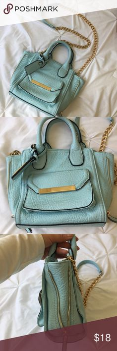 Baby blue handbag Baby blue handbags. Gold hardware details. Chain crossbody strap                                                                       No trades Aldo Bags Crossbody Bags