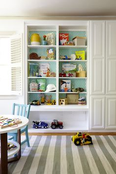 love the papering on the bookshelf wall