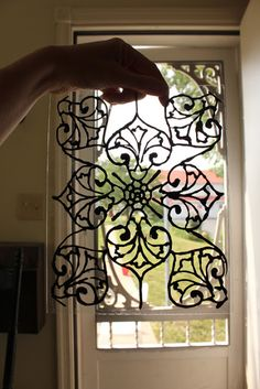 DIY:  Faux Stained Glass Tutorial - using liquid leading & glass paint. You can apply this to your windows & remove without ruining your glass. Great fix when you need privacy but don't want to block the light.