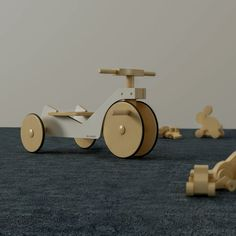 Tricycle made in plywood and varnished wood with matte finishing