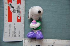 Peanuts Snoopy holding Easter Egg and Wearing Bunny Slippers PVC Figure @ niftywarehouse.com #NiftyWarehouse #Peanuts #CharlieBrown #Comics #Gifts #Products
