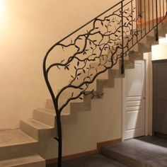 Wrought iron tree sculpture morphs into a traditional looking stair railing. Wrought iron tree sculpture morphs into a traditional looking stair railing. Metal Handrails For Stairs, Iron Handrails, Modern Stair Railing, Wood Handrail, Wrought Iron Stair Railing, Stair Railing Design, Iron Staircase, Modern Stairs, Banisters