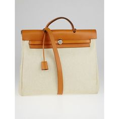 Pre-owned Hermes 40cm Natural Toile Canvas and Vache Calfskin Leather... (1,660 CAD) ❤ liked on Polyvore featuring bags, handbags, canvas handbags, hermes handbags, crossbody tote, canvas purse and handbags purses