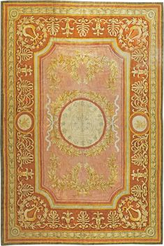 A neoclassical early 20th century Spanish Savonnerie carpet, the pinkish camel…