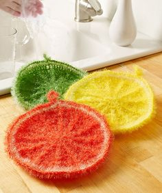 You'll love these citrus rounds for washing dishes or scrubbing the sink! This textured yarn has a sparkle effect, is easy to crochet with and can be thrown in the washing machine to keep it fresh.