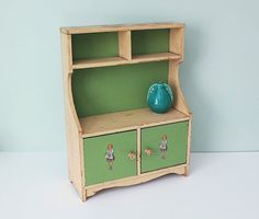 From my personal collection... Vintage Child's Doll Cupboard Toy Hutch with Two Doors and Charming Decals