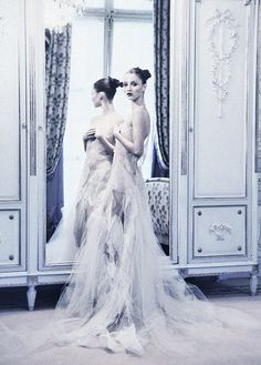 Romantic Reflections: Audrey Marnay is photographed at The Ritz hotel in the editorial 'Ravishing Couture'