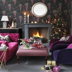 Glam black and fuchsia Christmas living room - we love how festive this is!