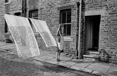 Martin Parr GB. England. West Yorkshire. Yorkshire. Cornholme. Washing drying in the street. 1975.