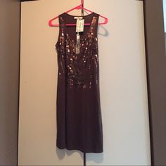 Brown sequin tank dress! Cute brown dress with brown sequins that look copper in the light. New with tags. Never been worn. Size does run a little small. I would say fits more like a medium or maybe even a small. Would look cute with leggings or by itself. Yalosangeles Dresses Mini