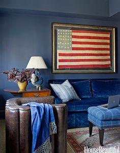 Study walls painted Benjamin Moore's Newburyport Blue set off a striking Civil War-era flag.