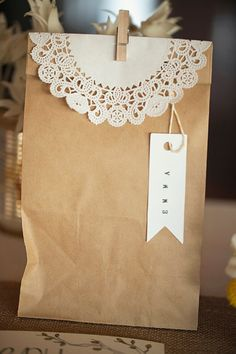 Brown paper bags and lace doilies. Photo by Something Blue Photography.