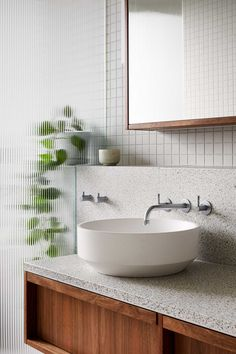 This Modern Bathroom Is Filled With Terrazzo Tiles And Countertop - - Architecture firm Fieldwork has designed a modern bathroom with a built-in bathroom, terrazzo tiles, a floating wood vanity, and a textured shower screen. Grey Bathrooms, Bathroom Renos, Glass Tile Bathroom, Modern Bathroom Sink, Natural Bathroom, Ensuite Bathrooms, Modern Shower, Glass Tiles, Bathroom Styling
