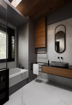 In this modern grey, black, and wood bathroom, curved elements like the mirror and the basin reflect the curved interior shape of the bath. best bathroom decor Chevron Patterns And High Ceilings Can Be Found Throughout This Home In Kiev Interior Design Blogs, Interior Design Inspiration, Design Ideas, Design Trends, Design Fails, Design Styles, Bad Inspiration, Bathroom Inspiration, Wood Bathroom