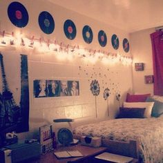 Vinyl Record and christmas lights give a vintage feel in a dorm room!