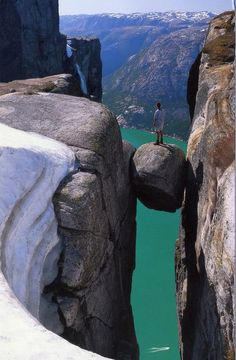 Kjeragbolten is the name of a massive bounder that's wedged and completely stuck between the walls of two steep cliffs in Kjerag Mountains, Norway.