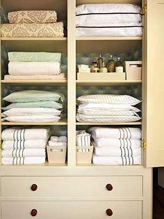 A small cabinet with doors and drawers can suffice for bed and bathroom needs if you pare down. Such a clean look! So me!
