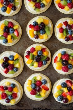 Chewy sugar cookies are topped with cream cheese f… Individual mini fruit pizzas. Chewy sugar cookies are topped with cream cheese frosting and loaded with fruit for a delicious treat everyone will love! Fruit Pizza Cups, Fruit Pizza Frosting, Mini Fruit Pizzas, Easy Fruit Pizza, Easy Fruit Desserts, Easy Cheap Desserts, Easy Summer Desserts, Sugar Cookie Cups, Chewy Sugar Cookies