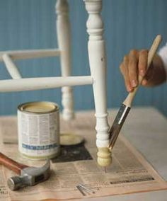 Use nails to hold up furniture while you paint!