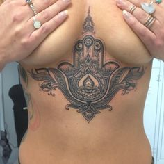 I absolutely love this  Gorgeous hamsa hand sternum tattoo