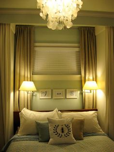 Bedroom ideas- lamps on the walls and curtains behind the bed. | Young House Love