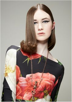 Sleek middle parting hair style
