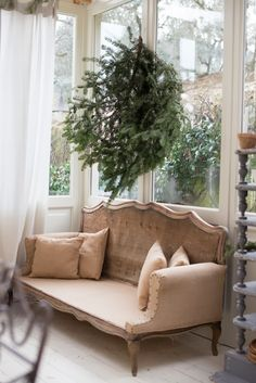 this sunroom is beautiful and that couch, what a dream!