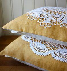 Upcycled. Tuuni makes pillows utilizing vintage doilies.