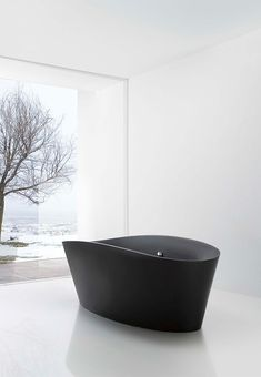 charcoal bath tub for two - with a winter's day view. grey white clean lines