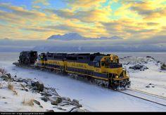 An Alaska Railroad diesel duo haul the last remaining ARR steam locomotive south of Anchorage, Alaska, by Dave Blaze; via Railpictures.net