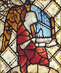 Angel playing an Organetto, stained glass, 16th century from the Evreux Cathedral