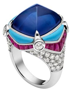 Bulgari Blue Sugar Loaf Sapphire with Turquoise Diamonds and Rubies in a White Gold Setting via Sultanesque
