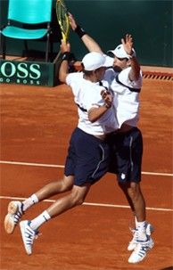The Bryan Brothers, kings of doubles tennis, doing their famous chest bump after a win.