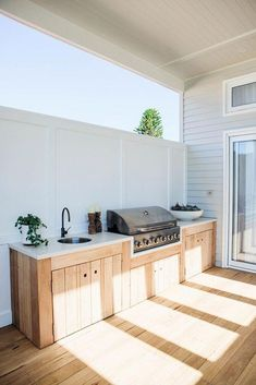 an outdoor kitchen with fully-integrated appliances, blackbutt - Modern Outdoor Kitchen Patio, Outdoor Kitchen Cabinets, Outdoor Kitchen Design, Outdoor Living, Outdoor Decor, Rustic Outdoor, Outdoor Ideas, Small Outdoor Kitchens, Outdoor Rooms