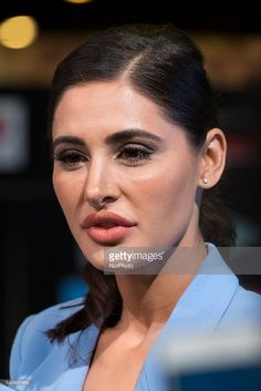 Indian Bollywood actress Nargis Fakhri poses on the green carpet as she arrives to the 17th edition of IIFA Awards (International Indian Film Academy Awards) in Madrid on June 24, 2016.