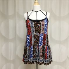 Retail SALE NWT Boho Tunic Gorgeous floral tunic. Perfect for those hot summer days!! No trades. Generous discount with bundle. Comes in small medium and large. Tops Tunics