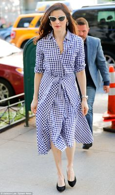 Check it out: Rachel Weisz, 47, sported a gingham shirtdress by Rosetta Getty as she hit the streets of New York City this week