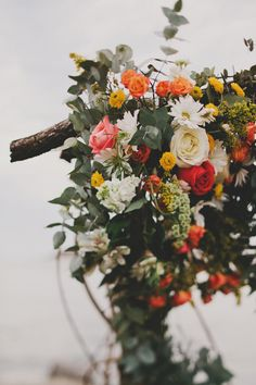 floral ceremony arch, photo by Red White & Green Photography http://ruffledblog.com/swansboro-backyard-wedding #wedding #ceremony #altar