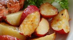 Red potatoes are baked with butter, garlic, lemon juice and Parmesan cheese. Easy, delicious side dish.