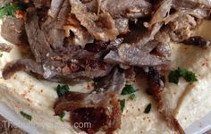 Lamb Shawarma over Hummus from Al Ameer   http://www.chowzter.com/fast-feasts/north-america/Detroit/review/Al-Ameer/Lamb-Shawarma-over-Hummus/1945_1920