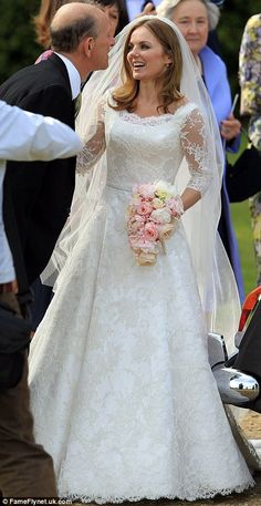 Blushing bride: Geri gave a full view of her simply stunning dress as she mingled with guests on the church grounds after the wedding.