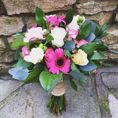 Tropical hot pink bridal bouquet. Gerberas, roses and eucalyptus. Blossom and Bramble