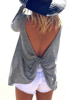 Traveling this holiday season? This sexy grey asymmetrical knot back top is an excellent piece for layering clothes to keep you feeling cozy during your flight or train ride.