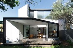 An articulated two-storey framed volume is sensitively stitched to the rear original fabric, while retaining its front Federation masonry and hipped envelope. House Extension Design, Extension Designs, Extension Ideas, Contemporary House Plans, Modern House Design, Modern Architecture House, Residential Architecture, Atrium Design, Window Reveal