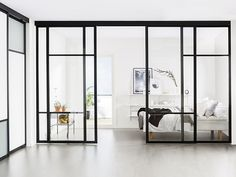 Did you know that you can use Elfa sliding doors as room dividers? See our sliding door designs and choose a suitable room divider for your home here. Sliding Door Room Dividers, Glass Partition Wall, Sliding Wall, Sliding Glass Door, Closet Doors, Room Deviders, Internal Sliding Doors, Verre Design, Front Doors With Windows