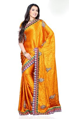 Image from http://www.indianfashiontrend.com/images/product_images/4/Gold-Satin-Designer-Party-Wear-Saree-with-Nice-Border.jpg.