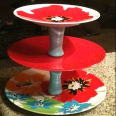 DIY Stand. 3 plastic plates from Walmart different sizes and the spacers are shot glasses from pier one that are spray painted.