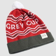 "CFL Grey Cup Red Toque. It's survived an attempted heist & ransom, a three-alarm fire blaze, and over 100 victory celebrations (we can only imagine how wild those were). To say that the words ""Grey Cup"" are iconic would be an understatement. Rep your country's (and one of North America's) oldest sport trophy with these toques this season.  Proudly Made in Canada. Ottawa Redblacks, Sports Trophies, Grey Cup, Victorious, North America, Beanie, Canada, Knitting, Celebrities"