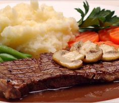 Grilled steak with mushrooms.The hot,spicy grilled steak and sweet mushrooms are a nice combination.A delicious dish for two.
